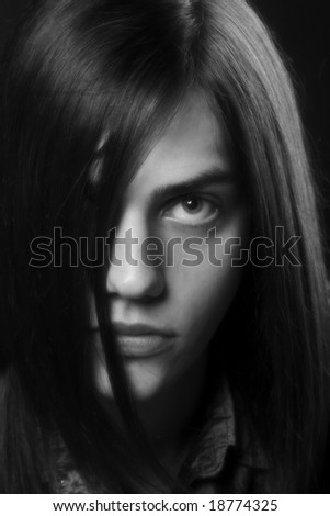 Close-up studio portrait of a young handsome man - stock photo