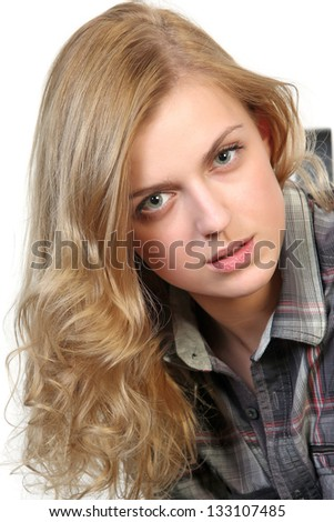Close-up studio portrait of young blonde beautiful woman. Isolated on white background - stock photo