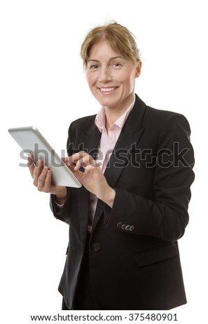 Close up studio shot of a mature business woman holding her tablet computer and smiling at the camera.  isolated on white. - stock photo
