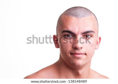 Close up studio shot of bald young man over white background