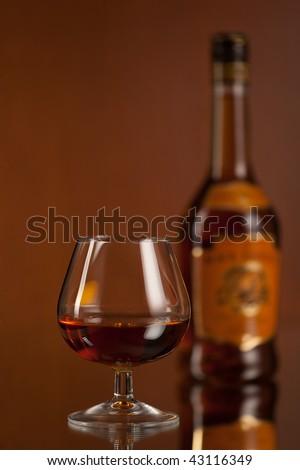 Close up studio shot of bottle of whiskey - stock photo