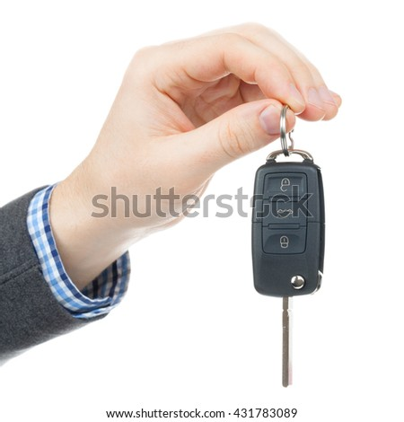 Close up studio shot over white of a male hand holding car keys