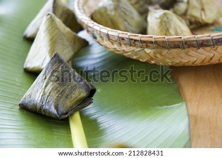 close up stuffed dough pyramid asian dessert put on banana leaf