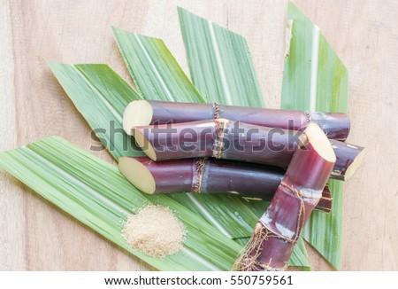 Close up sugarcane,Sugar cane on wood background.Close up Sugar cane on wood background.