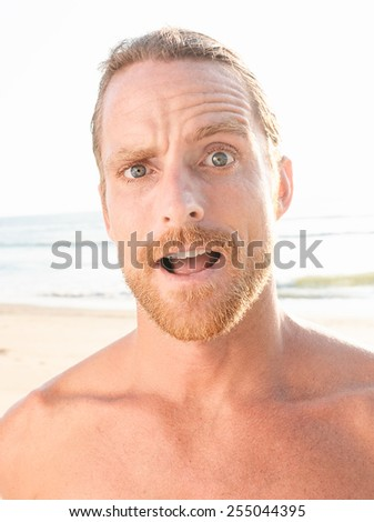Close up Surprised Bare Handsome Goatee Man with Blond Hair Looking at the Camera Open Mouth. - stock photo