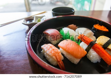 Close up Sushi set is placed in a serving Bowl style Japan. Japanese food Style.