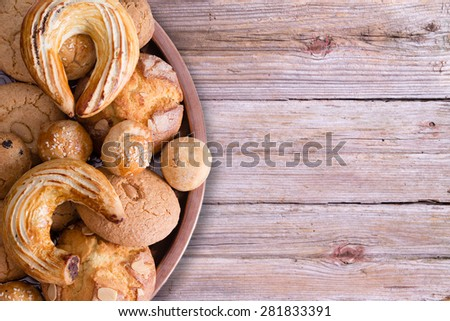 Close up Tasty Fresh Homemade Turkish Pastries on Tray with Croissant, Ay Coregi, Almond Macaroon and Other Mini Cookies, on Top of Wooden Table with Copy Space. - stock photo