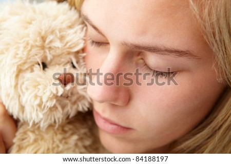 Close up teenage girl with cuddly toy - stock photo