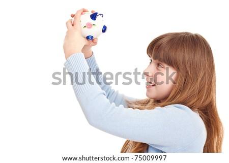 close up, teenager holding piggybank, isolated on white - stock photo