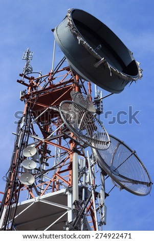 Close up Telecommunications antenna for radio, television and telephony whit cloud and Blue sky - stock photo