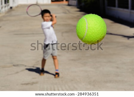Close up tennis ball fly closer from boy hit