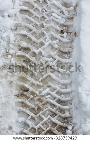 close-up texture background tire tracks in the snow  - stock photo