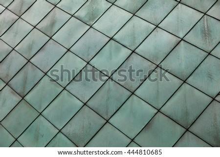 close-up texture of green facade exterior wall cladding - stock photo