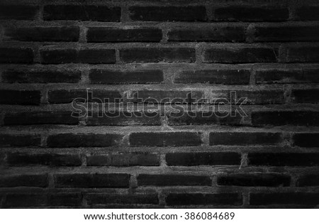 close up texture of layer vintage bricks in black and white color , dark vignette - stock photo
