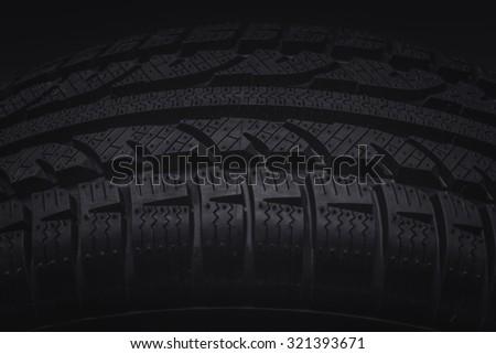 Close-up texture of tire, studio shot - stock photo