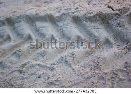 Close up texture of tire track on sand - stock photo