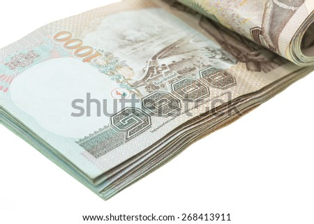 Close up Thai money in one thousand type banknotes isolated on white background - stock photo