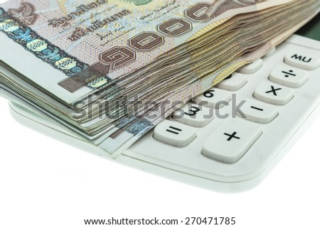 Close up Thai money in one thousand type banknotes with calculator isolated on white background - stock photo