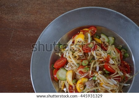 close up Thai spicy papaya salad on stainless steel dish
