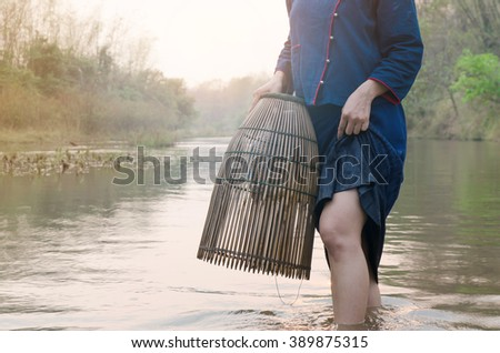 Close up,thai woman are fishing in river - stock photo