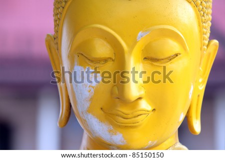 Close up the Buddha face,shallow dof. - stock photo