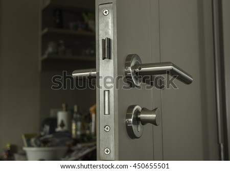 close-up the door face lock and silver handle in the room - can use to display or montage on product - stock photo