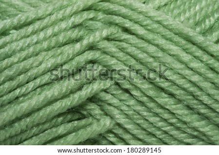 Close-up the green yarn used for knitting clothes.