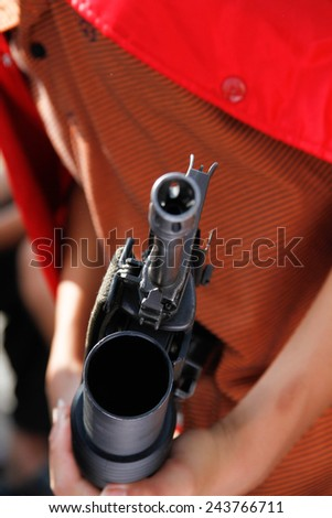 Close - Up the hands of men holding guns - stock photo