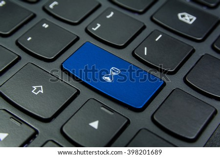 Close-up the Hourglass, Sand Glass, Sand Clock symbol on the keyboard button and have Azure color button isolate black keyboard