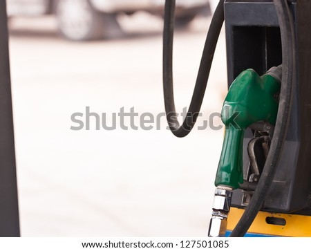 Close up the old Gas pump nozzles - stock photo