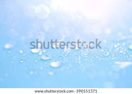 Close up the rain water drops on blue sponge surface as abstract background - stock photo