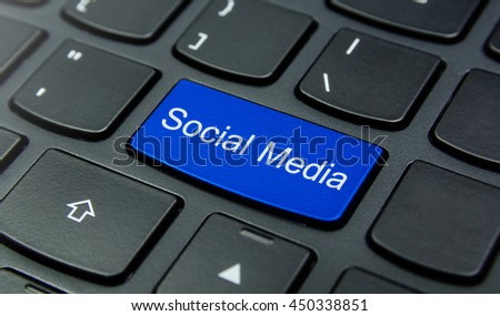 Close-up the Social Media button on the keyboard and have Blue color button isolate black keyboard