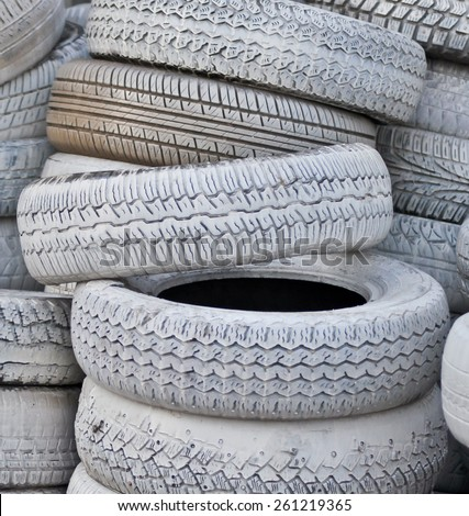 close-up. the white automobile tires dumped in a a big pile - stock photo