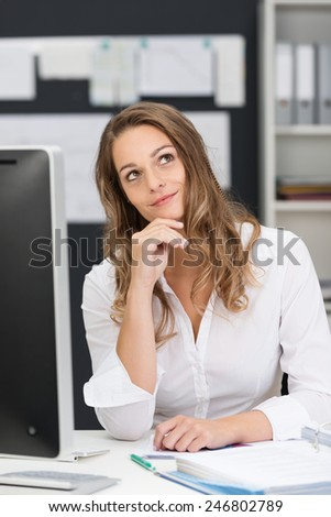 Close up Thoughtful Office Woman in White Long Sleeve Shirt Sitting at her Worktable with Computer.