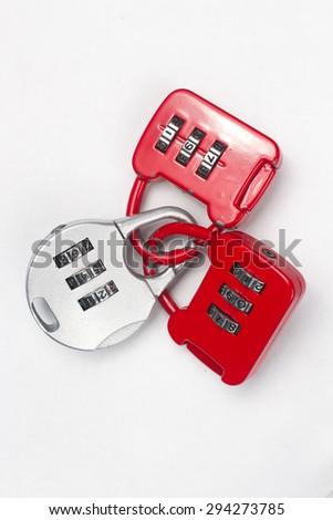 close up three combination padlock on white background  - stock photo