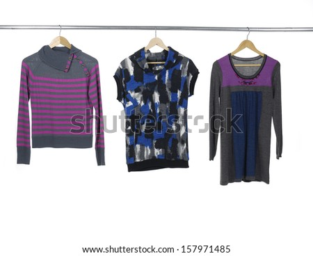 Close up three female clothes on a hanger - stock photo