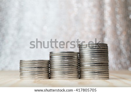 close up three stacks of coin with bokeh background - stock photo