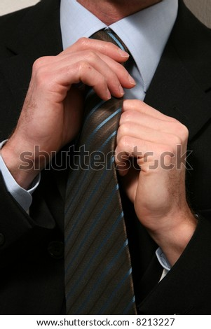 close up tie and hand