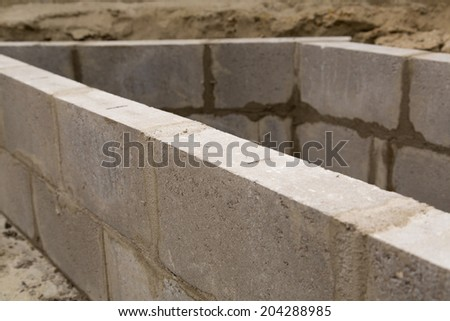 Close up tiles of a constructed wall outdoors - stock photo