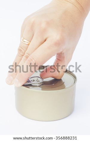 Close-up tin can with hand isolated on white background, stock photo - stock photo