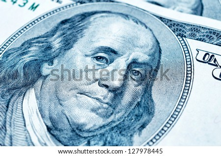 Close up to portrait of Benjamin Franklin on 100 dollar bill. Selective focus on face - stock photo