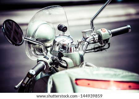Close up to scooter in city - stock photo