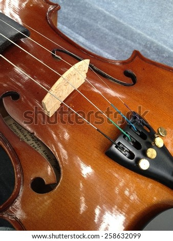 Close up to violin's body - stock photo