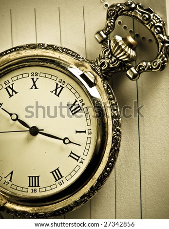 close up toned old pocket watch