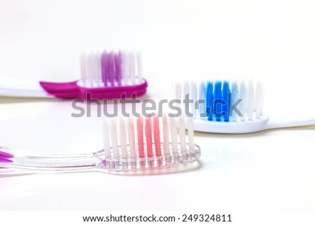 Close up tooth brush on a white background - stock photo