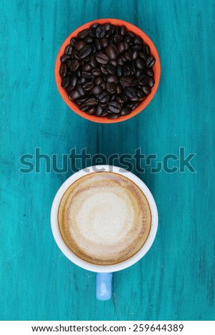 close up top view coffee cup on green wood background - stock photo