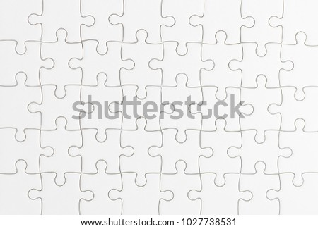 Close up top view shot of white jigsaw puzzel background