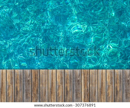 Close up top wooden floor with Turquoise water of the Koh Tao with coral reef below surface , Samui, Thailand , for background - stock photo