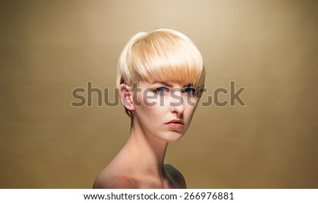 Close up Topless Attractive Young Woman with Short Blond Hair Looking at Camera Seriously on a Brown Background. - stock photo