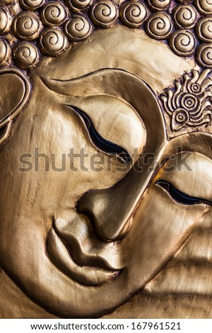 Close up Traditional Thai style Lord Buddha's face wood carving. Thailand   - stock photo